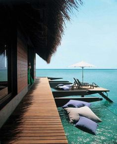 Tropical retreat in the Maldives with lovely hammock-esque netting over the water.