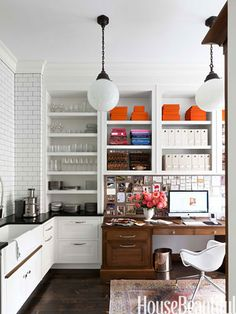 The kitchen pantry also houses a home office