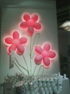 I saw this at Ikea.  The wires of the lamp can be set up to make them look like petals.  Love it