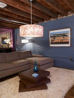 An unfinished basement: stain the ceiling, paint the walls, put in wooden floors.