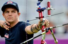 American Jake Kaminski shoots to win the Silver Medal in the Men's Team Archery final match against Italy at the London Olympics. (Photo: Jewel Samad/AFP/Getty Images)