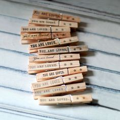 Clothespin Note Holder | dotandbo.com $16.99 W/ CLOTHE DRAW STRING BAG W/ 2 CLOTHESPINS BLACK PRINTS/STAMPED ON TOP.