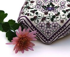 Lovely beaded biscornu pincushion.