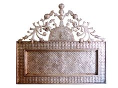 Awesome Mexican silver/tinwork headboard - mounts to the wall - could go so many other places than behind the bed. Behind a bench or console table. For the daring, behind a stove!