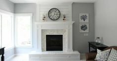 Grey walls, fireplace makeover with herringbone tile and white frame.