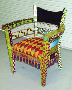 This chair frame I found on a curb. Painted, jeweled, stones, drippy trim, and new fabric on seat...  Traci Sampson