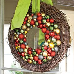 Layer a natural grapevine wreath with a glitzy ornament one and tie with colorful ribbon.