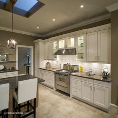 Kitchen colors, mixture of taupe/white/sable. Darker color on walls, lighter color on ceiling.