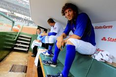 Anthony Rizzo and Joe Mather sit in the Cubs' dugout during the rain delay Friday