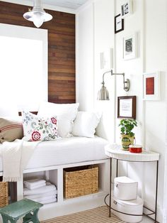built-in daybed/couch. I like the storage underneath. And the lamp is really cool as well. Looks pottery barnish. Also like the dark planking behind it all.
