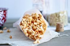 Give the popped kernels a good shake in a mixture of butter, olive oil, Sriracha, sesame seeds, garlic, and ground ginger.