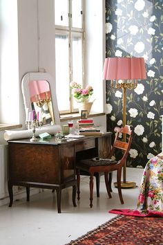 A gorgeous bedroom dressing table with vintage furniture and a large vintage floor lamp. That large lampshade is beautiful! I love the black wallpaper. I never thought I would say that