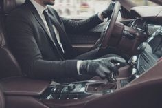 A fine suit, leather gloves and a fast car… Yes please!