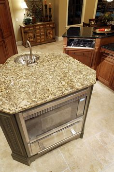 Small island with a contrasting color of granite compared to the dark granite used for the rest of the remodeled counters. #granite #counters #2tonecounters #woodcabinets