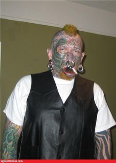 """Note to self: plan to quit smoking before lip stretching causes lit cigarette to rest directly on lip. *clicks off tape recorder*"" (text from http://ugliesttattoos.failblog.org/ )"
