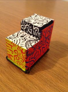 Ink cartridge paper weight. With just a little bit of paint and sand, you can turn an old ink cartridge into a convenient, compact paperweight!