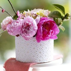 Instead of buying an expensive vase, decorate an old one. Here's how: http://www.bhg.com/holidays/mothers-day/gifts/mothers-day-flowers-ideas/#page=12