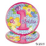 Thinking flowers as Laney's 1st birthday theme considering she was born on the first day of spring. :)