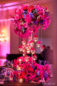 Beautiful #centerpiece at this #pink #uplighting #wedding #reception! #diy #unique #ideas #inspiration #celebration By #PamScott
