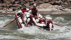 (Francisco Kjolseth  |  The Salt Lake Tribune)  Holiday River guide Julian Springer points the raft straight into a hole as Carol McWilliam and Bob Hollingsworth brace for impact while navigating the rapids of Cataract Canyon in July 2012.