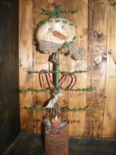 Prim Snowman Tree...in a grunged can...with candy canes.