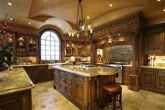 If you'd like your kitchen to radiate elegant charm, you probably want to select tile flooring and marble inspired counter tops with a darker wood cabinetry