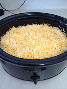 KING RANCH CHICKEN  Recipe  4 cups cooked chicken, cubed *** 1 large chopped onion 1 large chopped green bell pepper 1 10 oz can cream of chicken soup 1 10 oz can cream of mushroom soup 1 10 oz can of Ro-Tel tomatoes 1 4 oz can of diced green chilies 2 cloves garlic, minced 2 tsp chili powder 1package small corn tortillas, cut into 1″ strips 3 cups shredded cheese