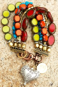 Caribbean-Inspired Bracelet: Red, Orange and Chartreuse Glass, Turquoise, Brass and Silver Heart Charm Bracelet.  Sold at this sight for $200, Shouldn't be to hard to make.