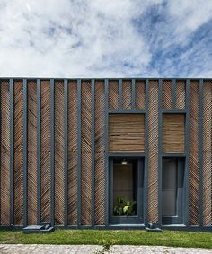 Anthony saved to furniturevilela florez arranges bamboo in a herringbone pattern for the facade of this brazilian residence -