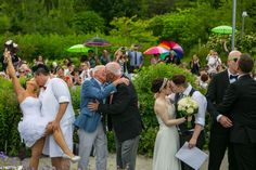 Newlyweds having their Big Fab Kiss #Toronto #Gay #Garden #Wedding