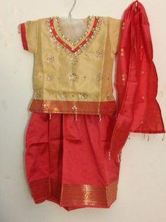 Coral & beige silk pattu pavada outfit for kids.