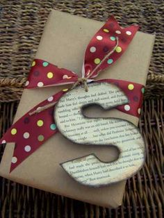 Kraft wrap. Recipient's monogram from a book, map or page of music. Nice smudged edging. All attached with a cute ribbon.