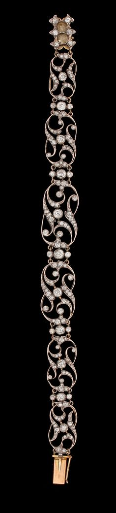 An antique cut diamond tiara/bracelet, late 19th century.  Silver/gold. L. 18,5 cm. Tiara stand later