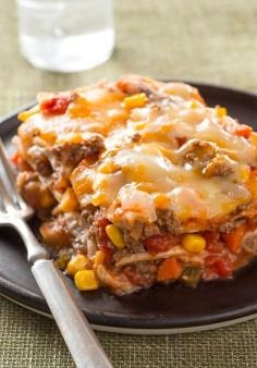 Layered Burrito Bake -- In this recipe, ground beef, salsa, refried beans and cheese are layered between tortillas for a burrito bake that's like a fiesta in a dish.
