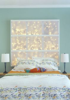 Cool DIY headboard or display.Cool DIY headboard or display. The process is quite simple. Build a simple wood frame from 2x4s, and add crossbeams. Drill small holes to put cords through in the bottom of each opening. Paint your frame and screw to the wall. Fill each space with lights and connect all cords. Cut translucent panels from polycarbonate sheet and fix to the frame with screws.