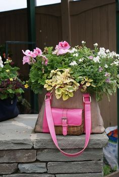Was a lovely pink purse...now it a container for beautiful flowers. Still have the purse and flowers, both to enjoy!! Awesome, love this!!