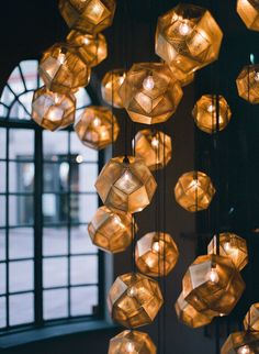 A cluster of  geometric lights. Etch Shades by Tom Dixon.