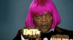 "Why is Samuel L. Jackson in a bright pink wig you ask? Jackson, host for this year's 2012 BET Awards, is starring in a number of promo videos for the event. ""Beez in the Trap"" is one of them, a short parody of Nicki Minaj's song with the same title."