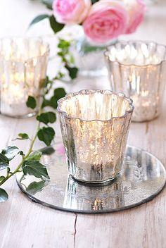 Chunky mercury glass votives sitting on a mirror base...twice the sparkle!