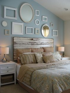 Our master bedroom, we're almost completely done! We used an old barn door for our headboard, and did a collage of vintage mirrors and vintage along with some newer picture frames!