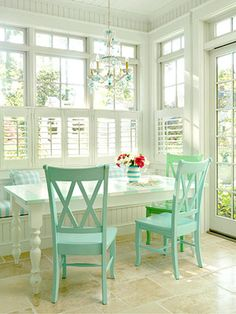 love the white windows, table and blue chairs!
