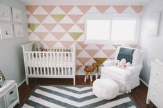 Love this geometric #nursery accent wall. Plus, we can't get enough #pinkandgold right now!