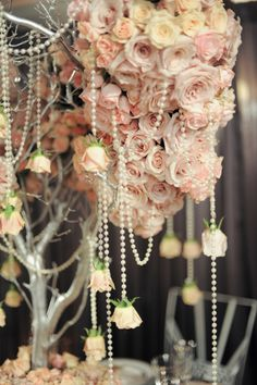 Dramatic flowers and pearls ... this would be a gorgeous over a buffet table, cake table, or head table at a wedding.