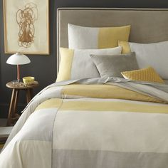 Gray + Yellow colorblocked bedding. Inspired by classic shirt stripes, Steven Alan designed this handcrafted bedding in collaboration with Eco Tasar, a cooperative that supports rural Indian spinners and weavers.