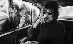 Bob Dylan in a taxi with fans 1966
