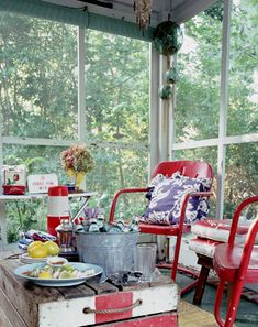 cute colorful screen porch - love the vintage red chairs