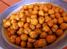 Drain and rinse a can of chickpeas, toss them with some spices and a little oil, roast them for 8-10 minutes at 180°C