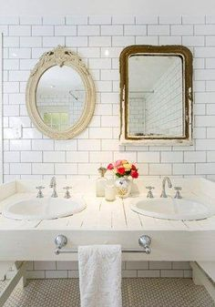 I love the non-matching mirrors! So cute. One of the houses we are looking at needs the mirrors replaced and I love this idea! Thrifting some cute non-matching mirrors is now on my list! decor, bathroom mirrors, vaniti, vintage mirrors, sinks, bathrooms, bathroom designs, bathroom ideas, subway tiles