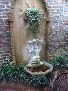 art garden, garden walls, charleston garden, garden statues, angel fountain