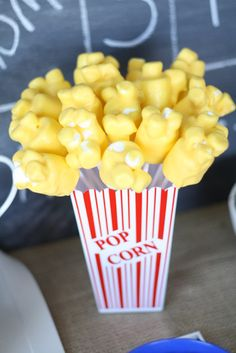 Popcorn goodies... Big marshmallows on stick with little marshmallows on top dipped in yellow frosting? Fun snack/treat :)